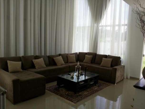 linda casa com 4 suítes sendo 1 master, todas com ar condicionado, living com lareira, sala...