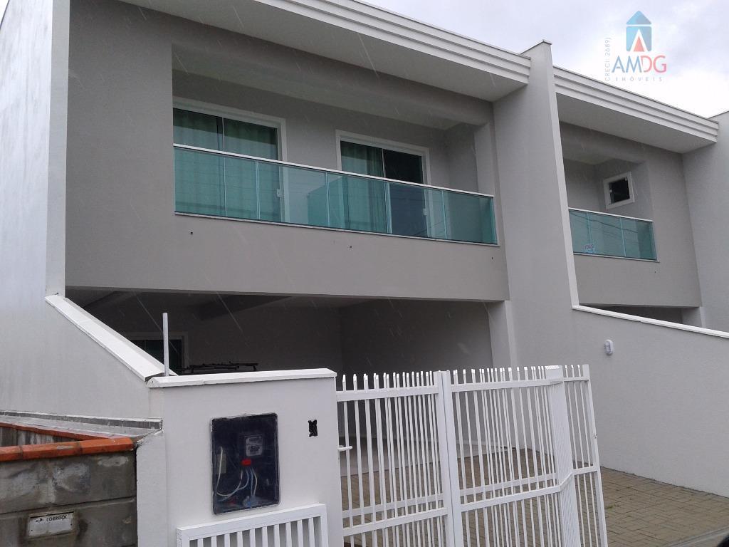 Sobrado residencial à venda, Meia Praia, Navegantes - SO0096.