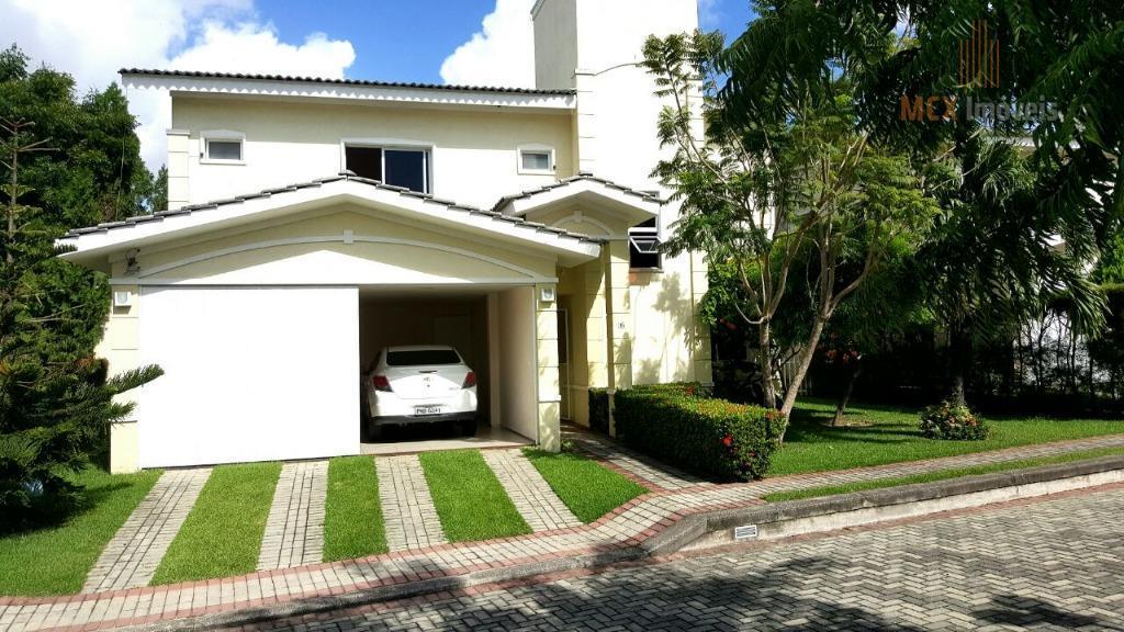 Excelente casa em condomínio  com 5 suítes e 4 vagas para venda e locação no Eusébio/CE.