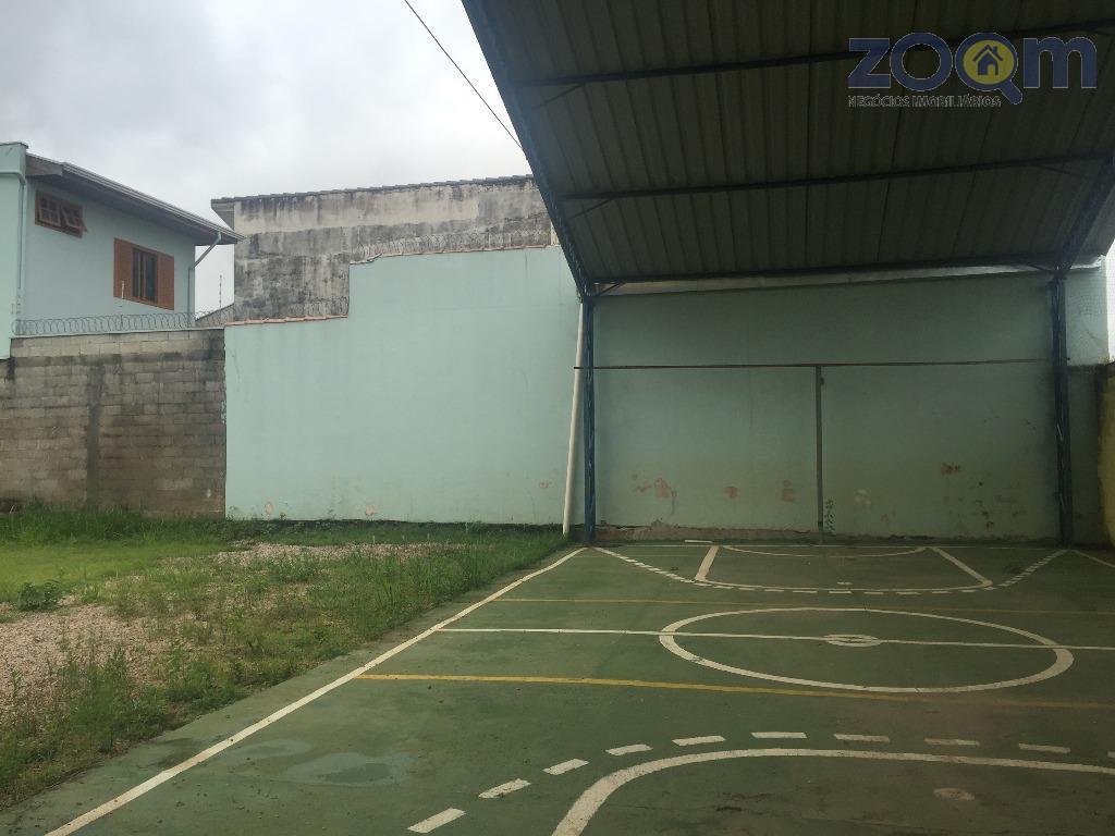 amplo terreno de 1200 m2 com uma construção térrea de 433 m2 contendo 9 salas internas...
