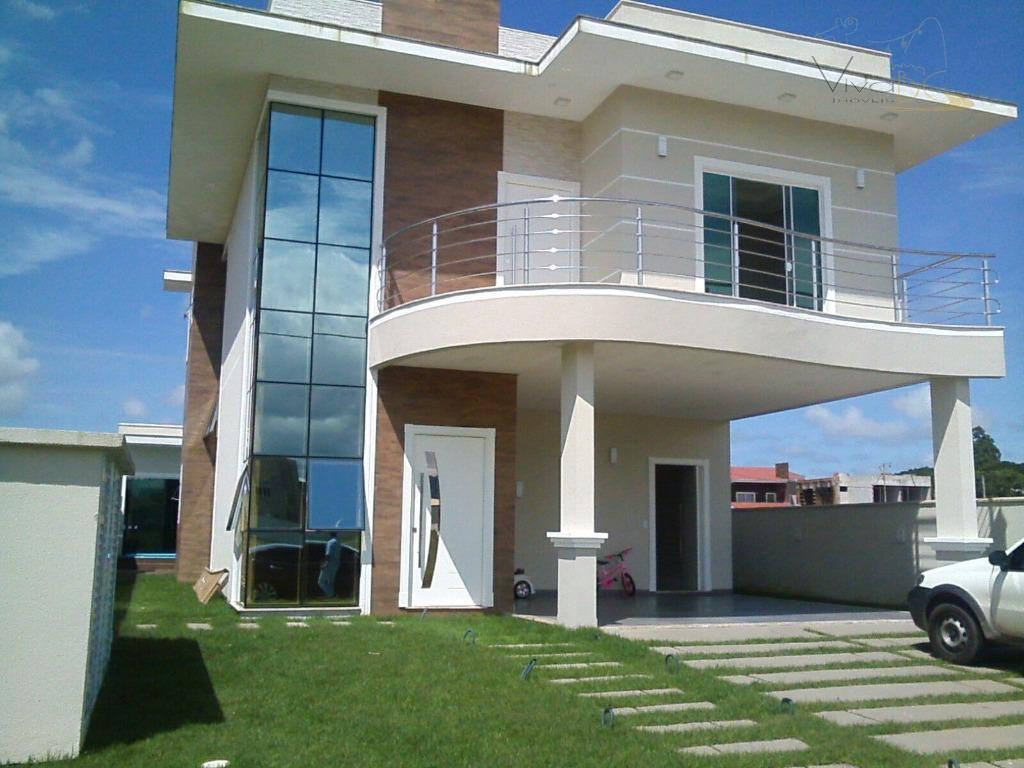 Excelente casa em condomínio fechado com 4 dormitórios, 3 vagas e área de lazer em Camboriú.