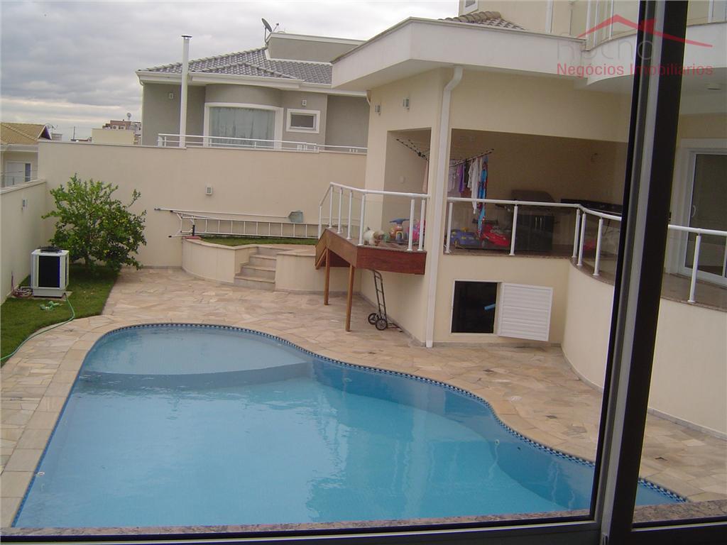 Sobrado 500 m² - lote esquina c/ 571,54 m², 5 suítes, hóspedes c/cozinha no térreo, sauna, piscina aquecida, poço artesiano