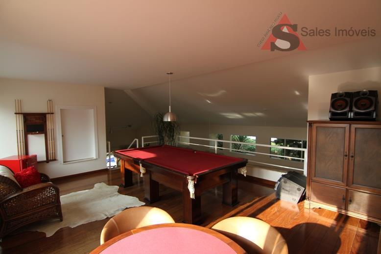 suite master com lareira e sala de banho,living em 3 ambientes,sala de jogos,espaço gourmet completo,amplo jardim,piscina...
