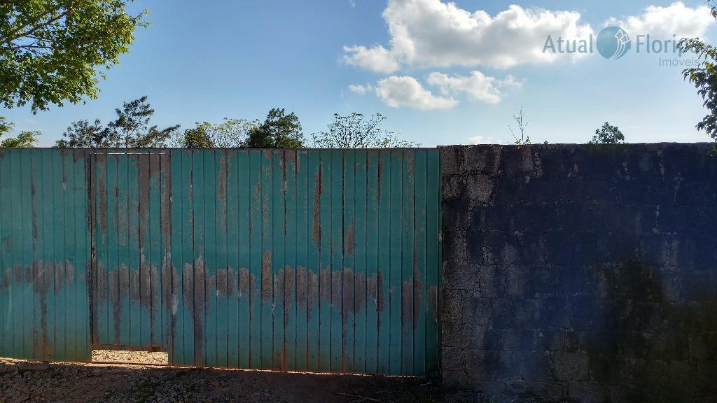terreno bem localizado, com 2000 m2, unifamiliar, com vista para o mar, todo murado.