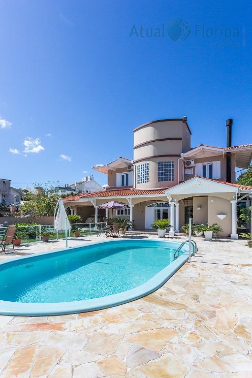 casa alto padrão de 04 dormitórios com 02 suites master, sala 02 ambientes com lareira, salão...