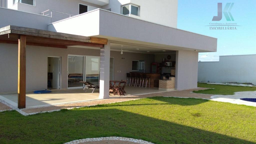 belíssima casa de frente para o lago em condomínio fechado com segurança 24h. espaçoso terreno de...