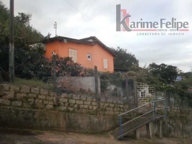 Casa com 3 dormitórios em Capoeiras - Florianópolis/SC