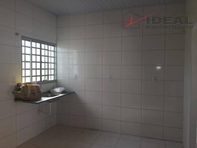 casa a venda localizada em rua pavimentada contendo dois quartos, sala, cozinha, área de serviço e...