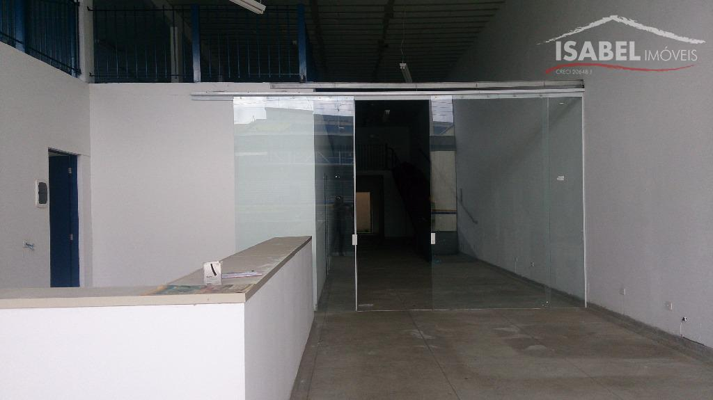 1 recepção, 5 salas, 5 banheiros, mezanino, área externa, 4 vagas de garagem.