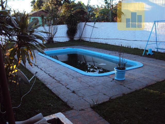 casa com 02 pavimentos com quiosque e piscina - terreno de esquinadisponibiliza de 04 dormitórios e...