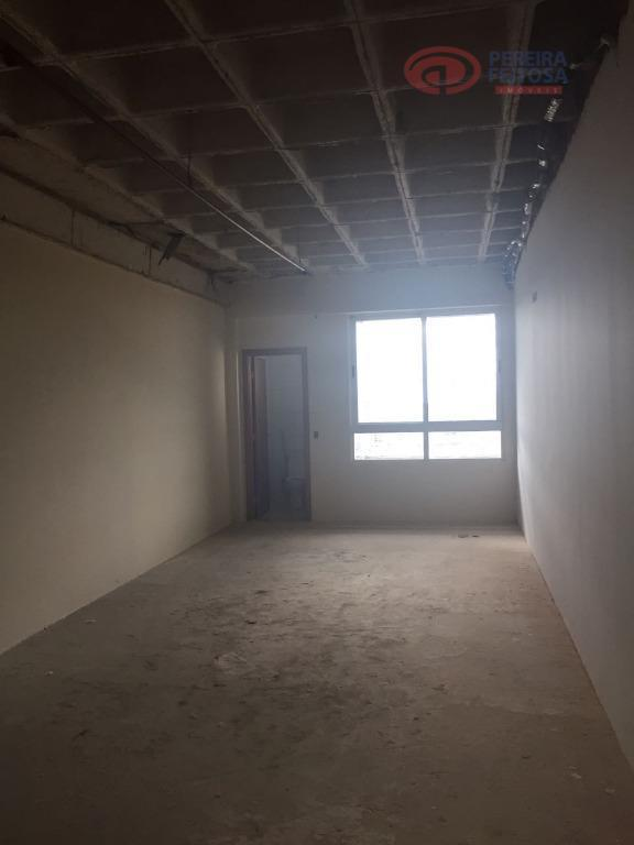 sala comercial com 35,53 m² composta de banheiro e uma vaga de garagem.