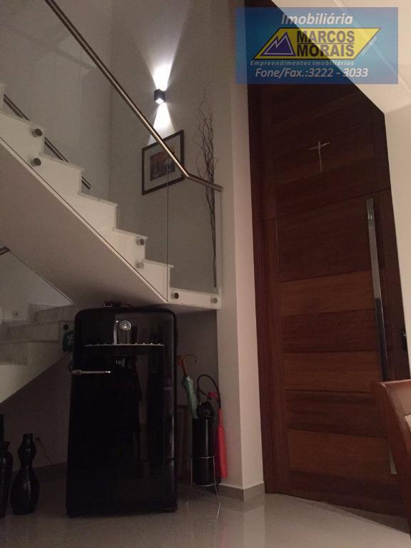 sobrado com 311,34m², 5 suítes, 1 master com hidromassagem e 1 no piso inferior, sala 2...