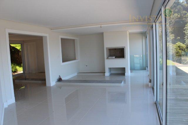 Casa de 4 dormitórios em Cacupé, Florianópolis - SC