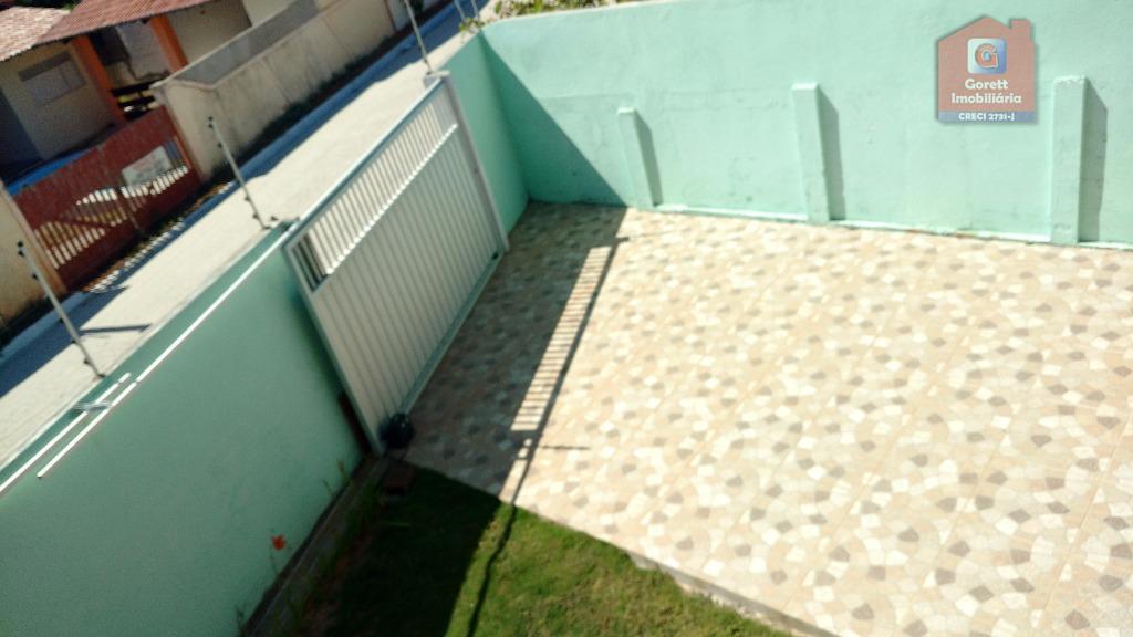 linda casa com varanda em l, sala para 02 ambientes com lavabo, sala ampla, cozinha com...