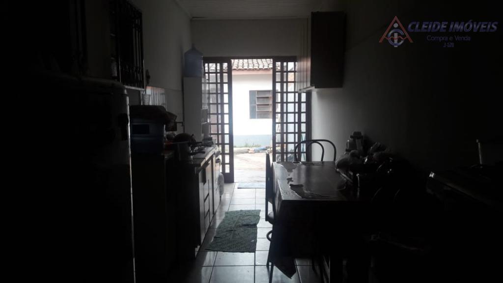 casa térrea com 03 quartos sendo 01 suíte, banheiro social, sala 02 ambientes, cozinha, edícula com...