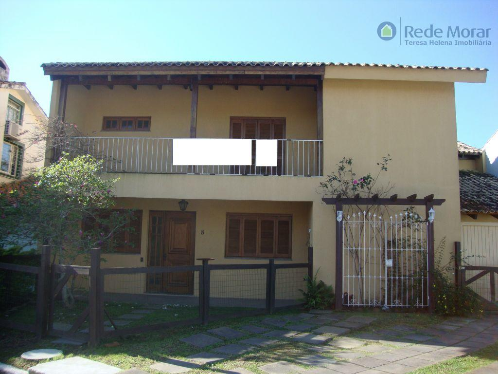 Sobrado residencial à venda, Guarujá, Porto Alegre.