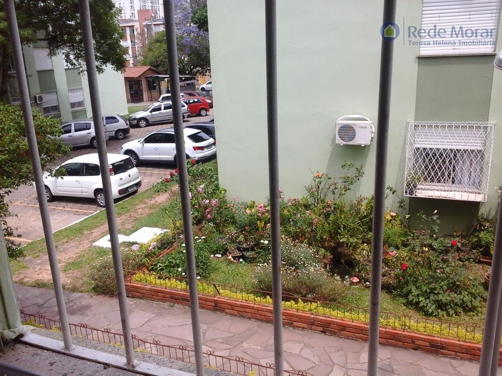 Apartamento três dormitórios à venda, Vila Nova, Porto Alegre.
