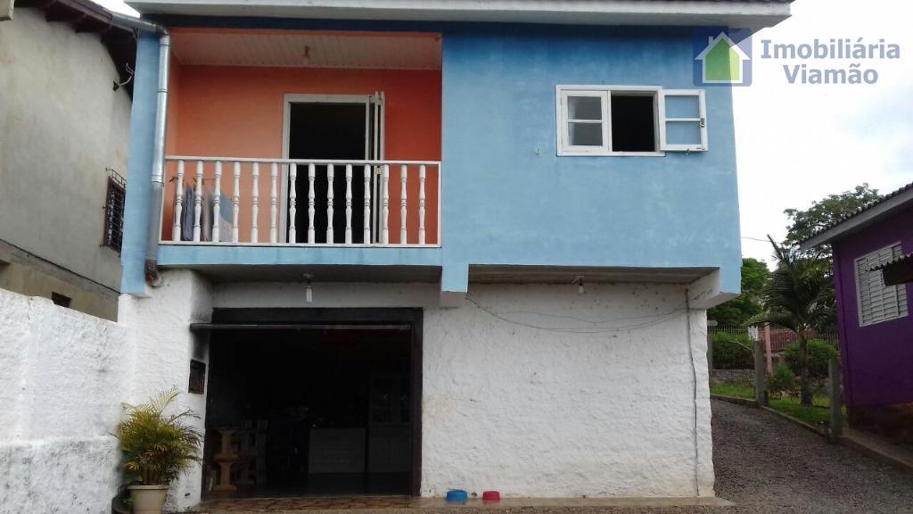 casa linda e de um ótimo bom gosto, com 2 dormitórios, sala e cozinha, um banheiro...