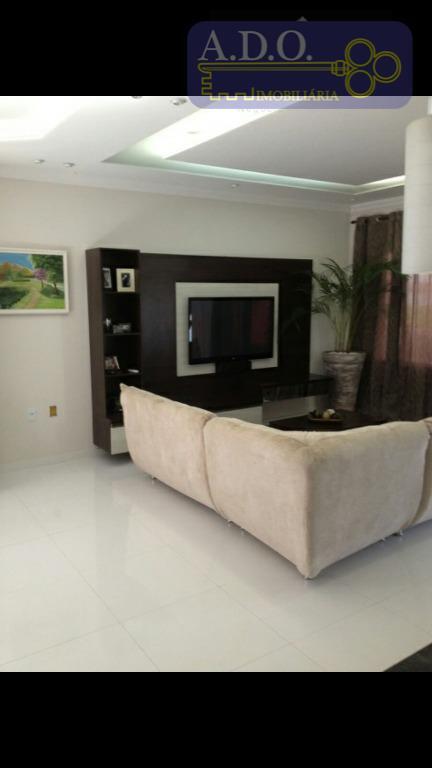 magnifica casa térrea de 3 dormitórios sendo 1 suite com closet, sala 2 ambientes com cozinha...