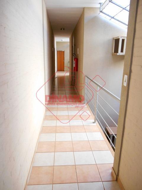 sala medindo 22,58 m², banheiro, recepção, estacionamento.