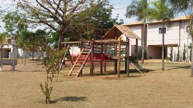 terreno medindo 340 m2, portaria 24 hs., com parquinho infantil e salão festas, plano, quitado, já...