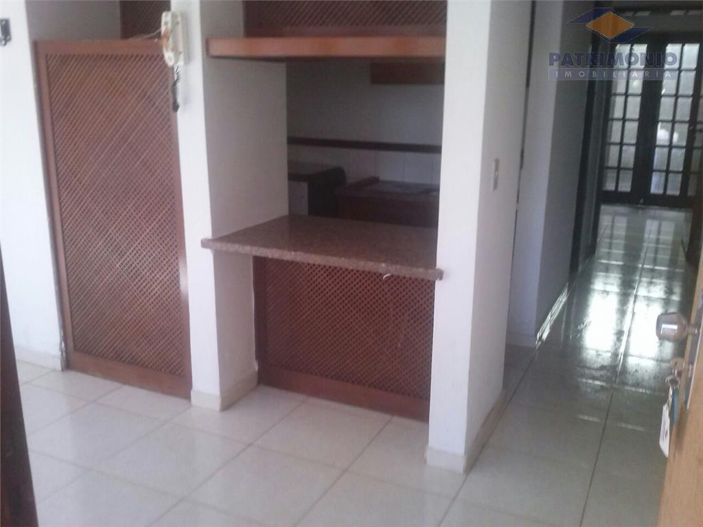 1 quarto,sala,cozinha,área de serviço,vaga de garagem.