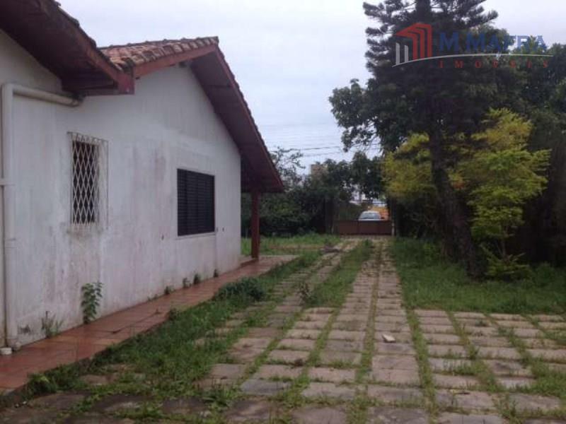 casa de alvenaria com 150 m², construída em um terreno plano e murado de 1.248 m²...