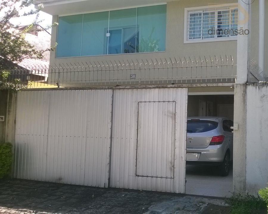 Sobrado residencial à venda, bairro Hugo Lange, Curitiba.