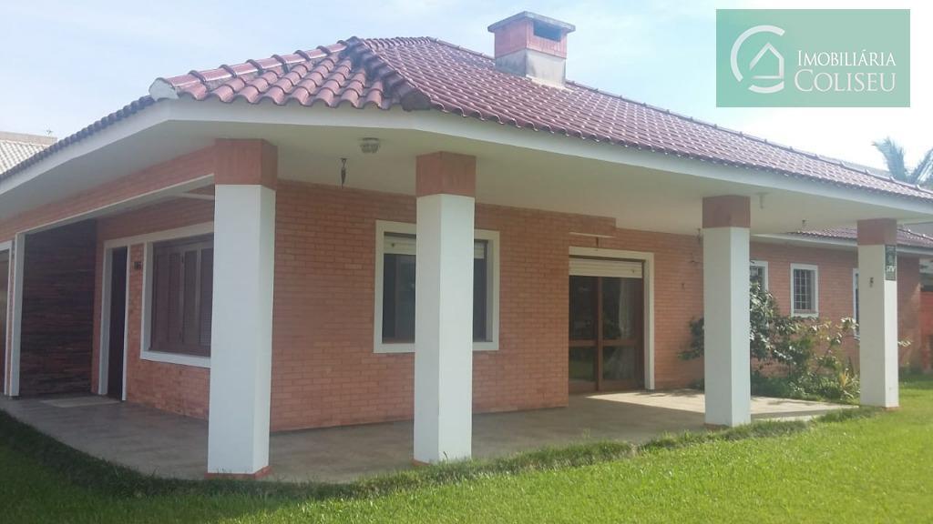 vende excelente casa mobiliada em xangri-lá à 3 quadras da praia com 4 dormitórios sendo um...