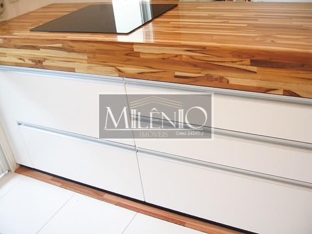 apartamento estilo loft, alto padrão, silencioso e agradável. cozinha com ilha integrada a sala de jantar....