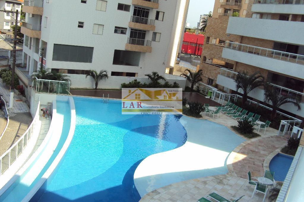 Um resort ... frente praia com 2 vagas de garagens e 2 dormitórios à venda, Vila Guilhermina, Praia Grande.