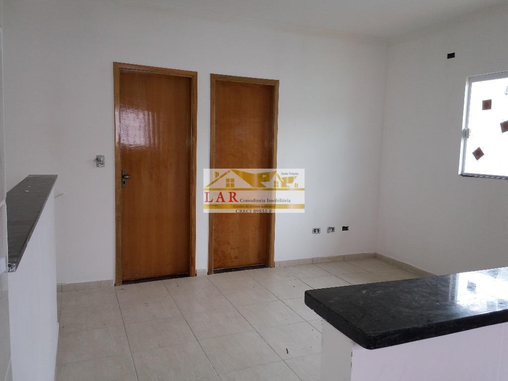 Casa residencial sobreposta alta à venda, Vila Tupi, Praia Grande.